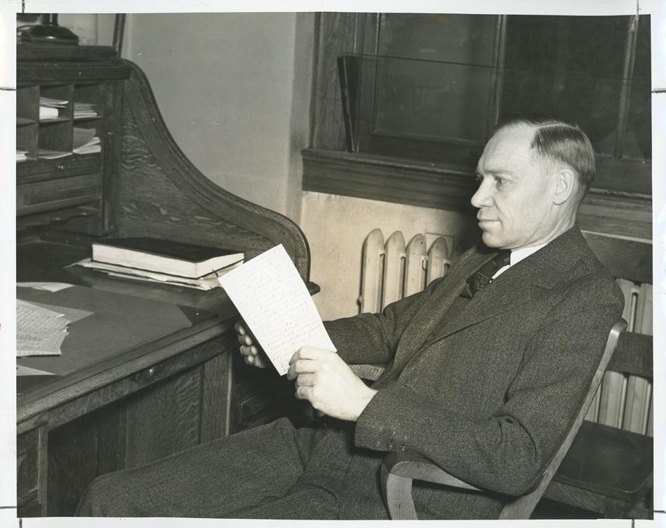 James L. Sellers at desk<br />