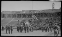 Soldiers Raising Flag at Stadium Dedication
