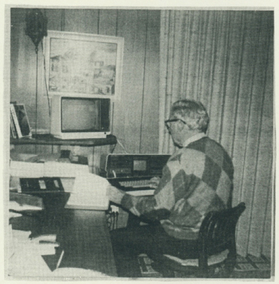 Jim Metzger sitting at computer.