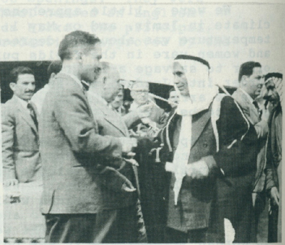 King Hussein handing the deed to the first farmer to receive a newly irrigated farm.