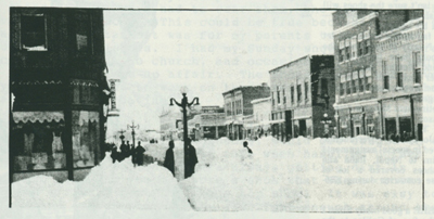 Lots of snow near Howe's drug store, 1 of 2.