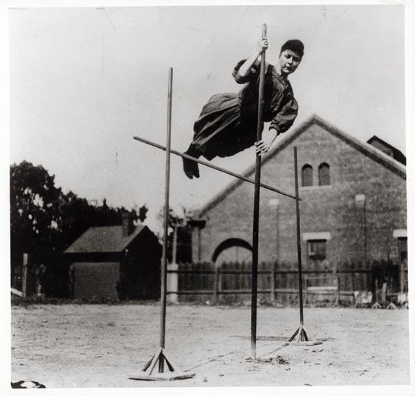 A photograph of Ida Giddings pole vaulting, c. 1911