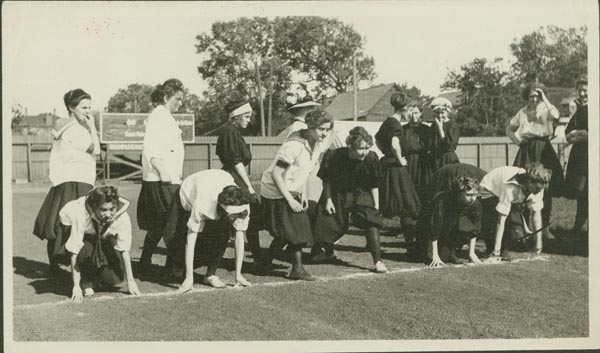 A photograph of female sprinters taking their marks, c. 1911