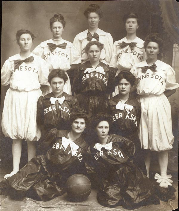 black and white photo; girls inter-class basketball pennant 1905 class team photo; 1901-2 won by class of 1905 class champions black and white photo of ten girls; five in white Minnesota uniforms, and five in dark Nebraska uniforms