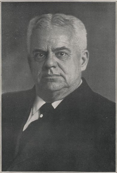 Head and shoulders photograph of Chancellor Canfield wearing suit.