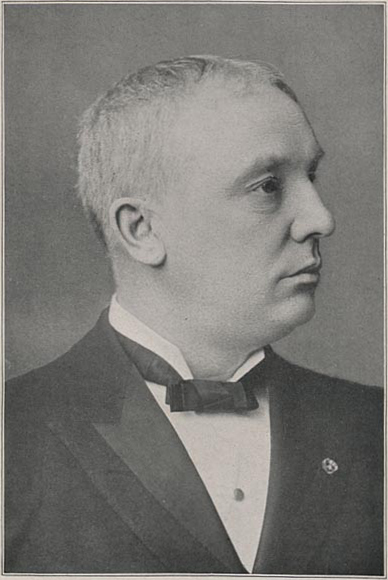 Head and shoulders photograph of Chancellor Andrews wearing suit with bowtie.