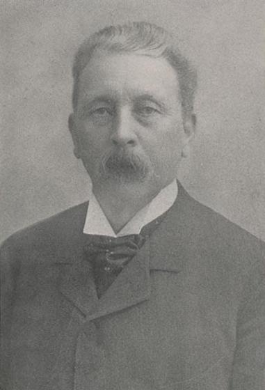 Head and shoulders photograph of Dead Edgren wearing suit coat.