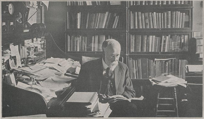 Head and shoulders photograph of Dead Bessey sitting in his office.