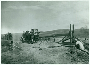 A photograph of an antique irrigation pump