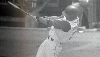 A photograph of Adelloyd Whiting Williams waving a University of Nebraska Banner, c. 1900.  DOI: 2006