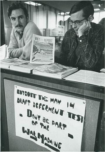 Carl Davidson (left) and another student at an SDS anti-draft booth, May 1966. DOI: 2