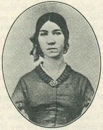 A photograph of Julia Beatrice Kinney seated, c. 1860.  DOI: 4